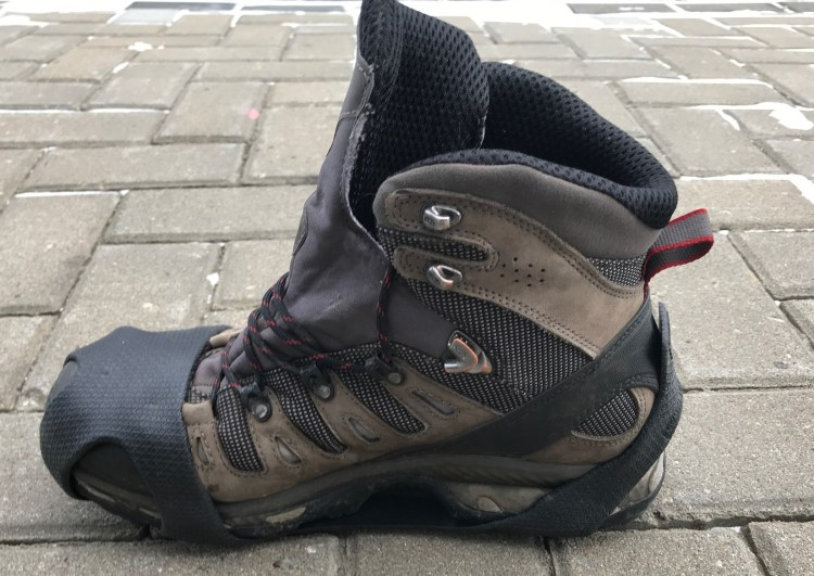 An image of a hiking boot with the MaxxDry GripOns ice cleat attached - Microspikes for hiking review.