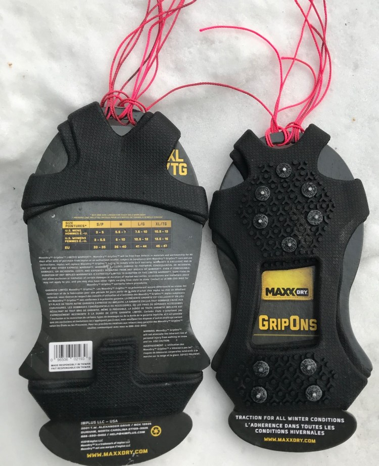 Image of Maxx Dry GripOns as they are packaged with string that we added in case trouble shooting is required.