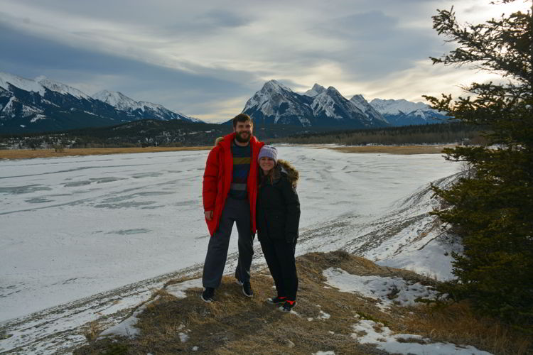 An image of a couple standing at Preacher's Point near Abraham Lake, Alberta