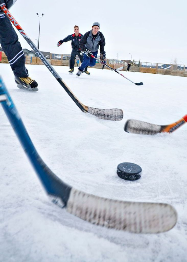 An image of children playing pond hockey in Red Deer - things to do in Red Deer.