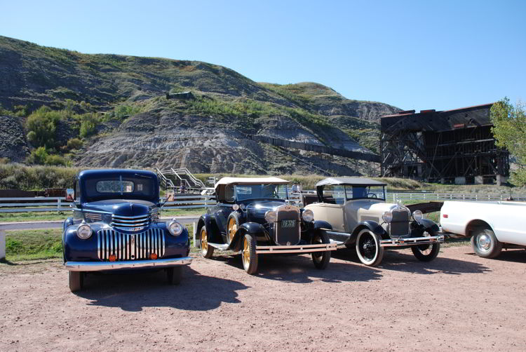 An image of some antique cars parked outside the Atlas Coal Mine near Drumheller, Alberta
