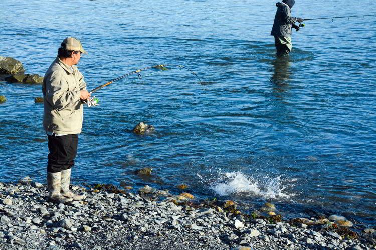 An image of two men fishing from shore in Seward, Alaska - Things to do in Seward, Alaska