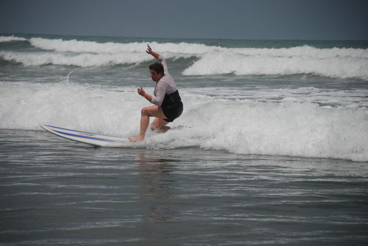 An image of a beginner surfer in Costa Rica at surf school.