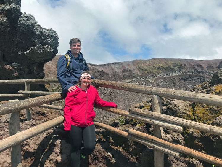 An image of two people standing near the caldera of Mount Vesuvius near Naples, Italy - Hiking Mt Vesuvius