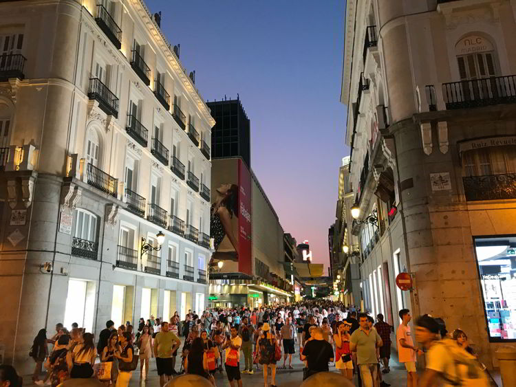 An image of a busy side street in Madrid, Spain.