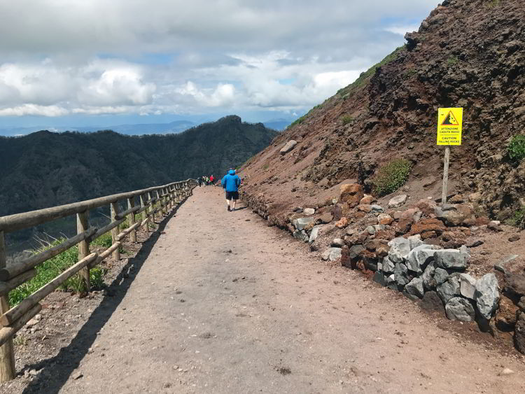 An image of as man hiking Mt Vesuvius in Naples, Italy.