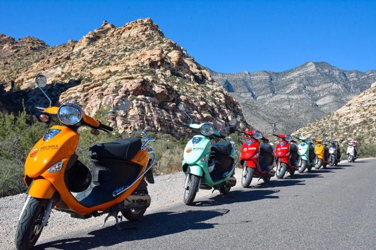 An image of scooters lined up in Red Rock Canyon Conservation area out side Las Vegas, Nevada.