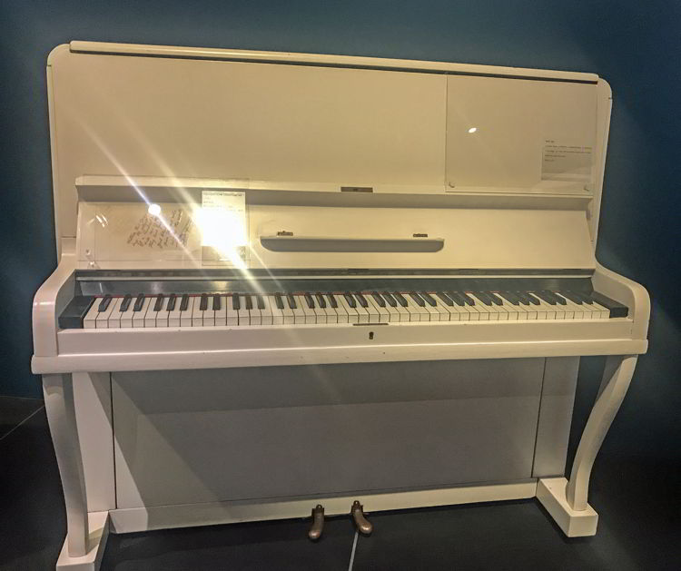 An image of Elton John's songwriting piano at Studio Bell in Calgary.