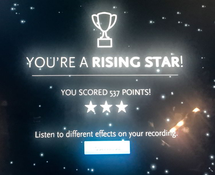 """An image of a computer screen that says """"you're a rising star"""" at Studio Bell in Calgary, Alberta, Canada."""