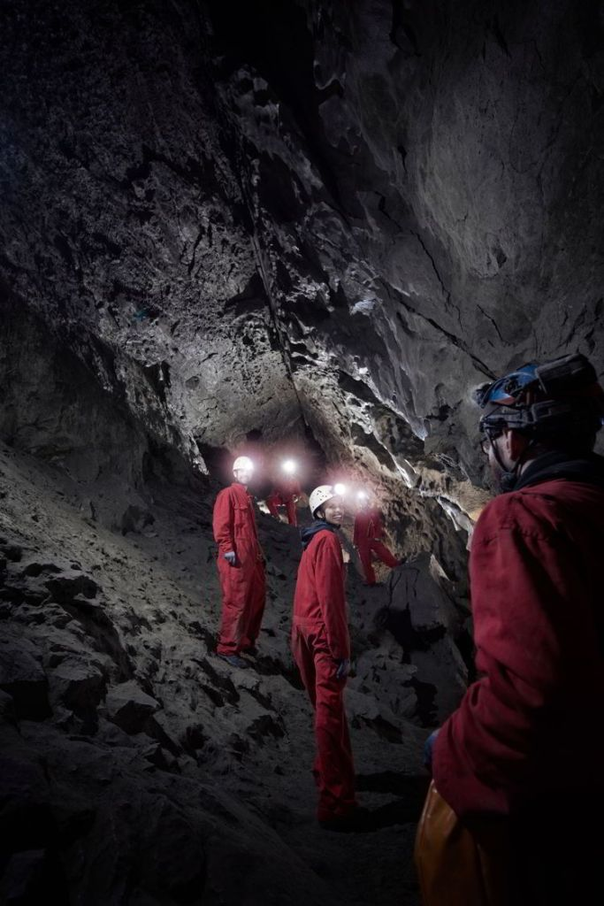 An image of a group of people on a Canmore Cave Tours in the Rat's Nest Cave in Canmore, Alberta.