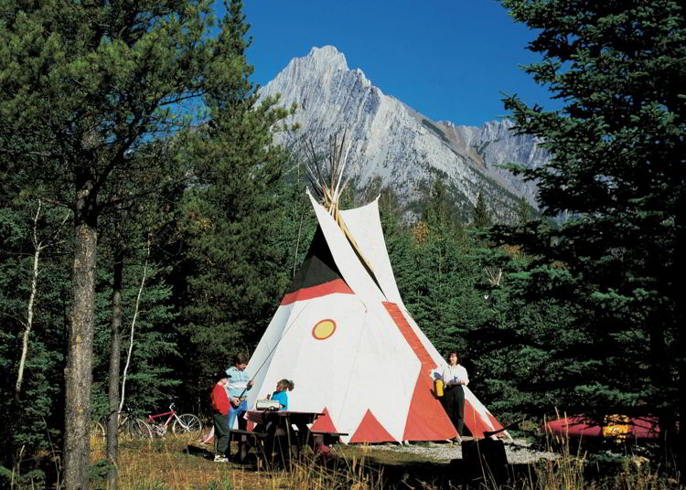 An image of the tipi accommodations at Sundance Lodges in Alberta, Canada.