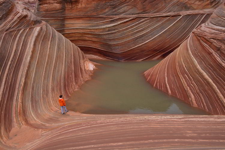 An image of a woman hiking the wave in Arizona, USA.