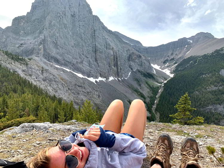 An image of two woman taking in the view on the Grassi Knob Trail in Kananaskis near Canmore, Alberta, Canada.