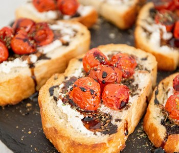 Roasted Tomato Bruschetta - Up your bruschetta game with roasted tomatoes, goat cheese and sweet balsamic reduction. You'll never go back after trying this!   wanderzestblog.com