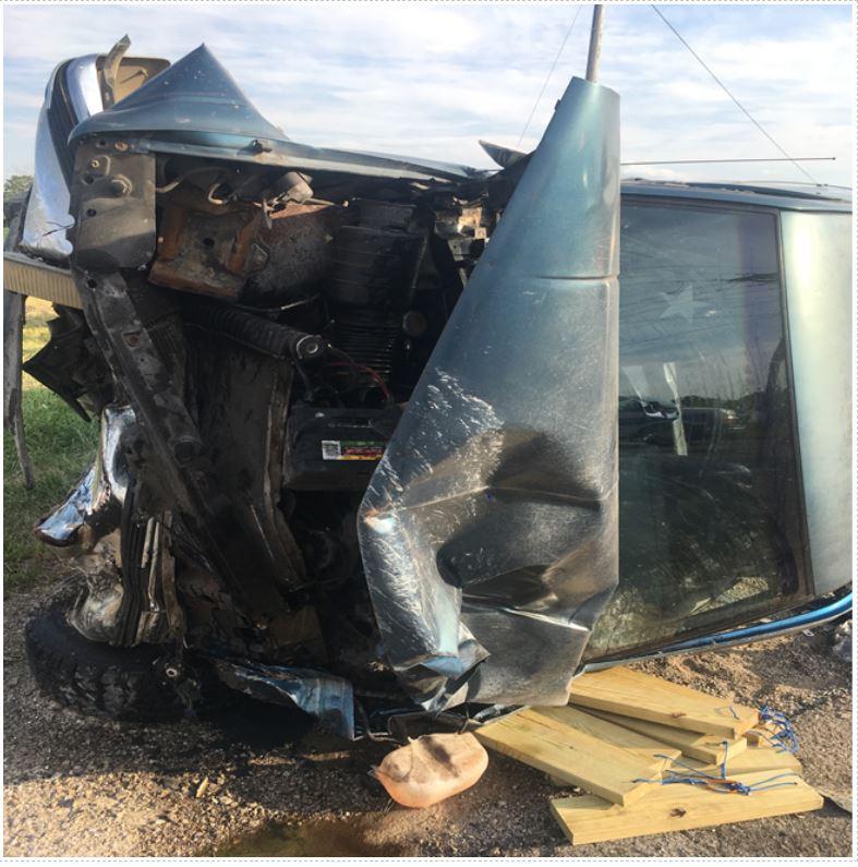 Crash flips vehicle onto side, three hurt | WANE