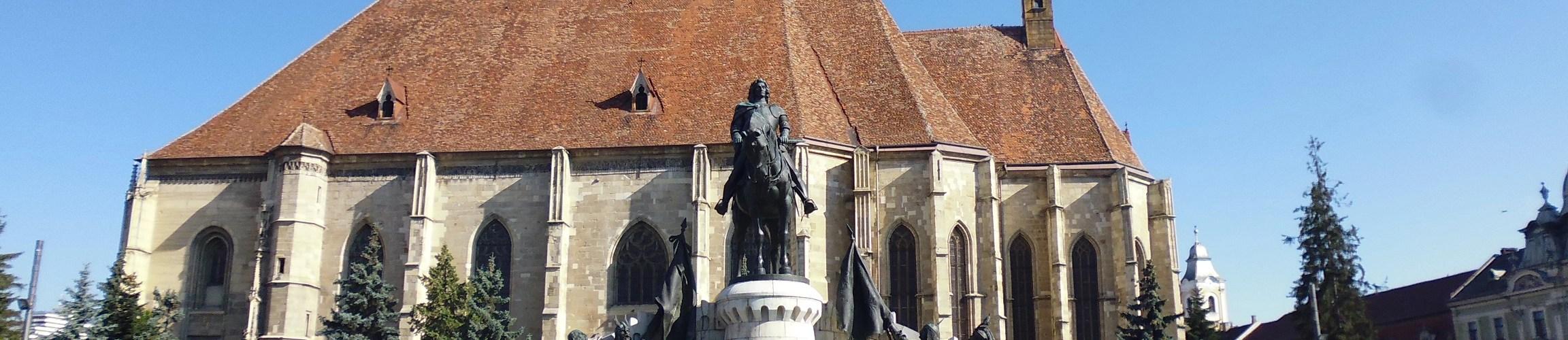 The statue of Matthias Corvinus and St. Michael's Church