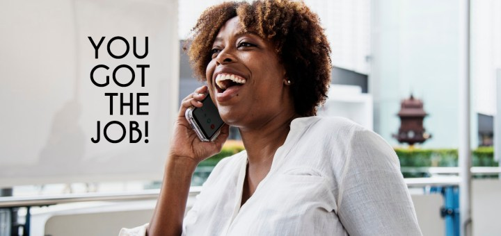 Woman on the phone getting job offer