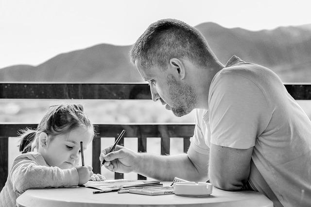 Parent hovering over child's homework