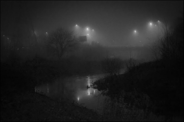 "© Geoff Wilkinson, who writes on Wanstead Daily Photo: ""Wanstead was covered in fog a couple of nights ago and because this is not a frequent occurrence, I grabbed the camera bag and instead of heading toward the High Street I went to the river Roding. I captured this mystical scene showing reflections in the river and the ghostly lights of the A406 in the background."""