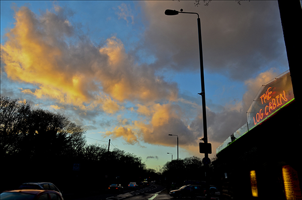 "© Geoff Wilkinson, who writes on his Wanstead Daily Photo blog: ""I was near Hollow Pond, Whipps Cross Road when the setting sun briefly lit up the clouds overhead . The Log Cabin cafe was close by and I spotted that the neon sign on the cafe was roughly the same colour as the illuminated part of the clouds. This for me made the picture."""