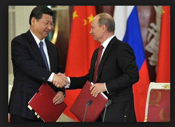 Russian President Vladimir Putin and Chinese President Xi Jinping signed the preliminary gas-supply agreement in Beijing as U.S. President Barack Obama arrived in the Chinese capital for the Asia-Pacific Economic Cooperation summit. The deal is slightly smaller than the $400 billion pact reached earlier this year, shortly after Russia annexed Crimea. Russian oil firm OAO Gazprom is negotiating the supply of as much as 30 billion cubic meters of gas annually from developments in West Siberia to China over 30 years, it said. At the same time, another Russian producer, OAO Rosneft, agreed to sell a 10 percent stake in a Siberian unit to state-owned China National Petroleum Corp.
