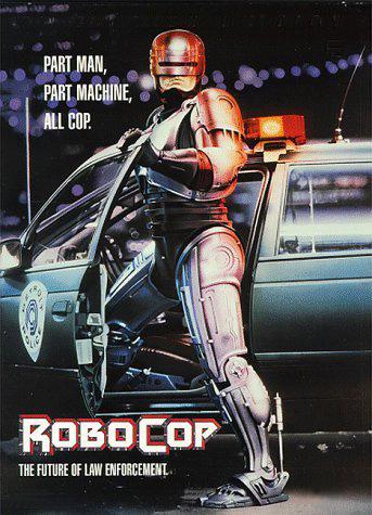 De succesfilm van Paul Verhoeven over de half-mens-half-robot agent, inspireerde kennelijk defensiespecialisten. Spreekt deze filmposter nog over 'lawenforcement', inmiddels wordt gesproken over vleesetende robot-machines op het oorlogsslagveld...