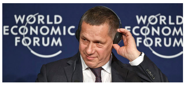 "Russian Deputy Prime Minister Yuri Trutnev adjusts his headphone during a panel ""The Outlook for Russia"" at the World Economic Forum in Davos, Switzerland, Friday, January 22, 2016"