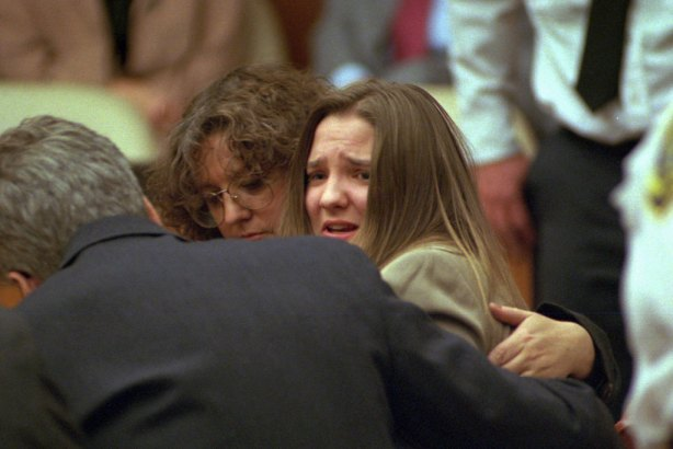 An emotional British au pair Louise Woodward is seen in Middlesex Superior Court, Thursday evening, Oct. 30, 1997, in Cambridge, Mass., as a jury finds her guilty of second-degree murder in the death of infant Matthew Eappen, who died in her care in February 1997.  In foreground is defense attorney Andrew Good, and in background Elaine Whitfield-Sharp, a member of the defense team. (AP Photo/Pool-Ted Fitzgerald)