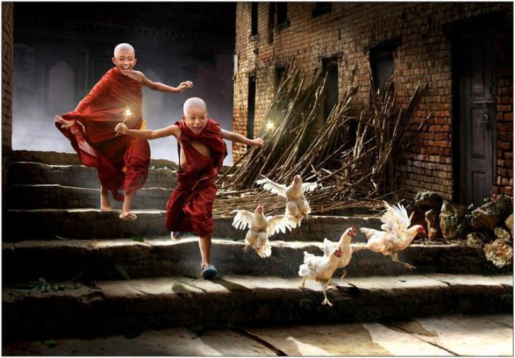 young buddhists with chicken