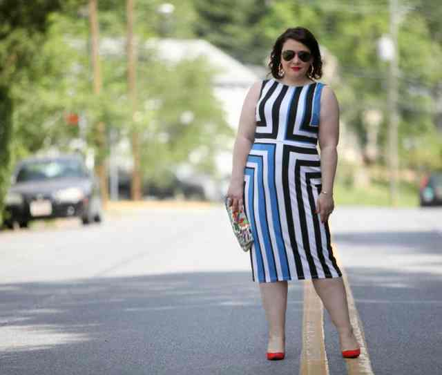Wardrobe Oxygen in a Vince Camuto black, white, and blue graphic dress, Novica clutch, and orange Nine West pumps