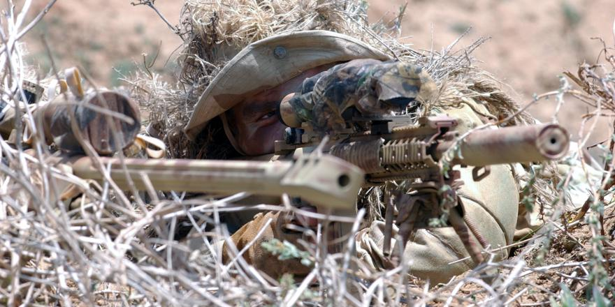 US Navy Seals with sniper rifles, including a McMillan Tac-50 (US Navy, 2004)