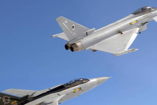RAF Typhoon F2 fighter aircraft (top) from 11 Squadron, RAF Coningsby, in close formation with a Tornado F3 formerly of the same Squadron (Crown Copyright, 2007)