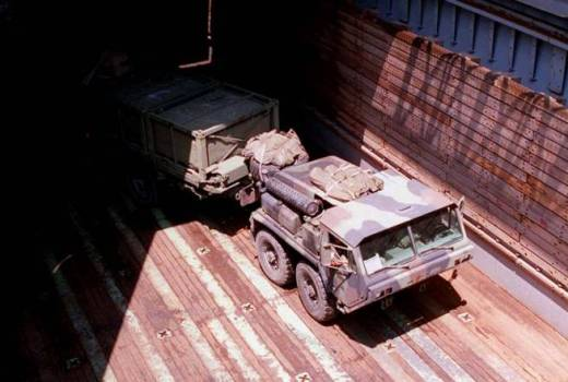 US Marine Corps Logistic Vehicle System from the Mobile Combat Service Support Detachment, turns around in the well deck of the USS Whidbey Island (USMC, 1996) [880]