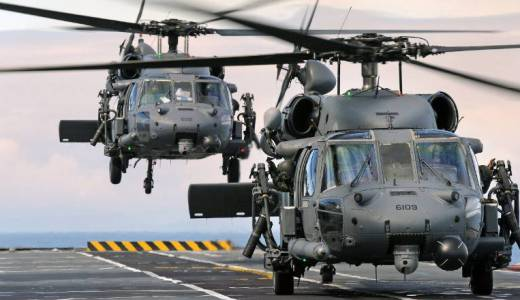 Royal Navy HMS Illustrious, US AH60 helicopters on Deck Landing Practice during Ex Joint Warrior (Crown Copyright, 2012)