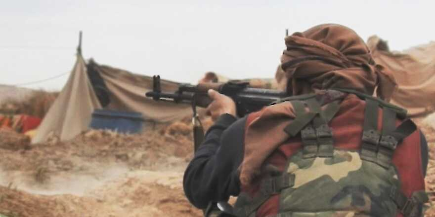 ISIS last stand in Baghuz, Syria, terrorist with AK47 (via ISIS Amaq) [880]