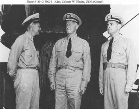 On board the USS San Francisco Lt. Commander Schonland (left), Admiral Nimitz, and Lt. Commander Bruce McCandless (right) via history.navy.mil