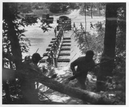 The 442nd in training: building then attacking across a pontoon bridge at Camp Shelby.