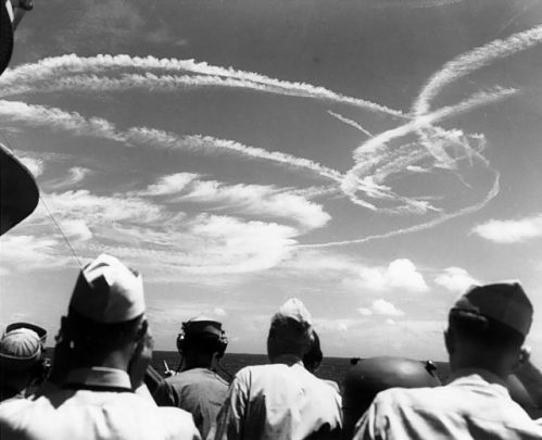 Fighter aircraft contrails mark the sky over Task Force 58, June 19, 1944