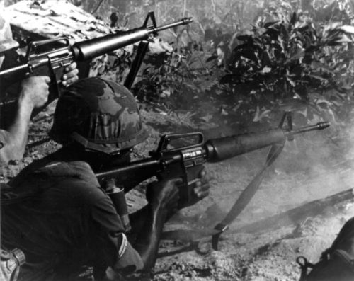 American_sergeant_&_rifleman_engage_enemy_with_M16s_in_Vietnam
