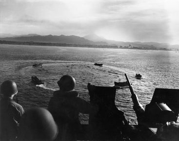 The American landing craft circling off Cape Torokina on Bougainville Island Photo Credit