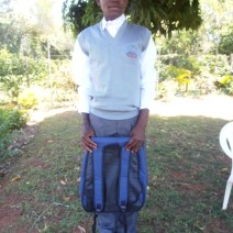 Alloyce and his school equipment