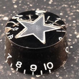Brand new speed knob with black with silver star inlay.