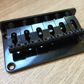 Black string through hardtail 6 string guitar bridge