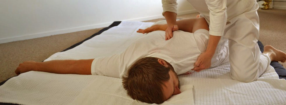 Massage Therapist doing Shiatsu massage