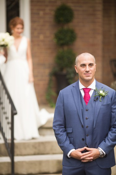 Kentucky estate wedding- Groom in navy blue suit waiting for first look