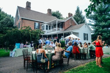 Outdoor wedding reception on back patio of Warrenwood Manor