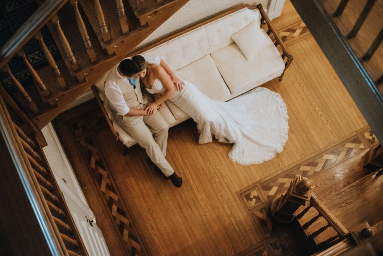 Southern charm bride & groom in entry hall of Warrenwood Manor, Photo by Rainwater Photography