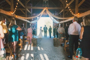 Warm earthy barn wedding ceremony at Warrenwood Manor