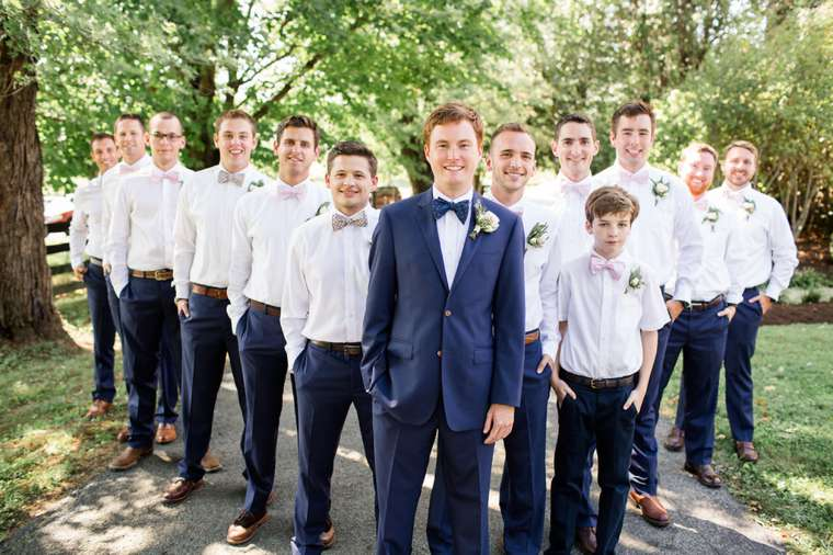 Groom with his groomsmen dressed in navy and white