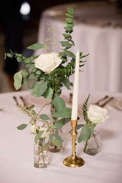 Bud vase centerpieces with white florals and eucalyptus at classy southern barn wedding